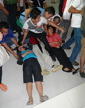 Slain in the Spirit - People slain in the Spirit after receiving prayer from faith healer and Catholic priest Fernando Suarez