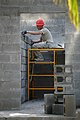 Squadron structural craftsman from Hurlburt Field, Fla., builds an inner wall of a new two-classroom schoolhouse in the village of Ocotes Alto, Honduras.jpg
