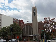 Photo of a Modernist Roman Catholic church on a cloudy day