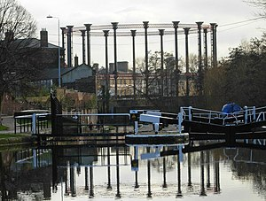 King's Cross Central - The iconic King's Cross gas holder reflected in the water of the Regent's Canal just above St Pancras Lock