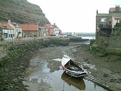 Coble in the river at Staithes at low water