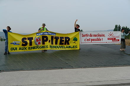 "Protest against ITER in France, 2009. Construction of the ITER facility began in 2007, but the project has run into many delays and budget overruns. The World Nuclear Association says that fusion ""presents so far insurmountable scientific and engineering challenges"". Stop-ITER Pertuis.jpg"