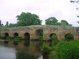 River Arun - Stopham Bridge near Pulborough. The centre arch was raised in 1822.