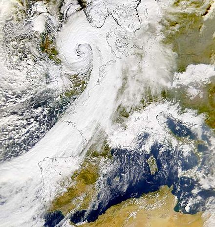 Cyclone Oratia showing the comma shape typical of extratropical cyclones, over Europe in October 2000. Storm Oratia 30 Oct 2000.jpg