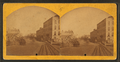 Street view in Oshkosh, by C. B. Manville.png