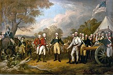 A color painting. In the center is the white-haired Horatio Gates, facing front, wearing a blue military jacket, yellow pants, and knee-length dark boots.  His right hand is reaching out to accept the sword of John Burgoyne, who faces to the right, and wears a red coat and white pants.  Behind and to his left is another similarly attired officer. Behind him, and to the left of Gates, are Continental Army soldiers wearing a variety of different uniforms; those on the right of the painting are standing behind a brass cannon, and to the far left is a blue-coated man on a gray horse.  The background on the left is countryside with hills visible in the distance, and a partly cloudy sky.  The background on the right includes a white tent, above which waves a flag similar to the United States flag, although it has a smaller number of stars on the blue field, arranged in a square.