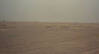 Battle of 73 Easting - An Iraqi defensive position in Task Force 1-41 Infantry's sector of operations during the Battle of 73 Easting. The top of Iraqi tanks can be seen as they sit in defensive entrenchments. More destroyed Iraqi armor sits in the distant background.