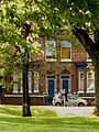 Terrace houses on Moss Lane East from Whitworth Park in Moss Side, Manchester - panoramio.jpg