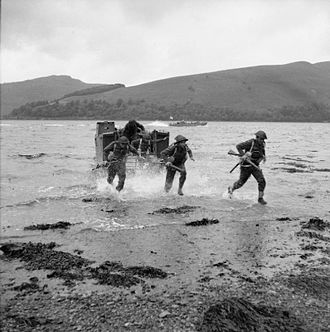 29th Infantry Brigade (United Kingdom) - Troops rushing ashore from a landing craft during combined operations training by 29th Infantry Brigade Group at Loch Fyne, Argyllshire.