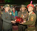 The Chief of Army Staff, General Bipin Rawat presenting the memento to the NCC Contingent from Bangladesh, at the NCC Reception, in New Delhi on January 16, 2018.jpg