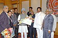 The Minister of State for Coal Dr. Dasari Narayana Rao presenting a cheque to the Prime Minister Dr. Manmohan Singh towards PMNRF in New Delhi on February 4, 2005.jpg