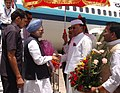 The Prime Minister, Dr. Manmohan Singh being received by the Governor of Jharkhand, Syed Sibtey Razi, on his arrival at Birsa Munda Airport, in Ranchi, Jharkhand on April 22, 2008.jpg