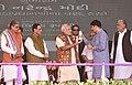 The Prime Minister, Shri Narendra Modi releasing a Bottle Pack of Kankrej A2 Milk to mark its launch in the market, in Palanpur, Banaskantha, Gujarat.jpg