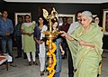 The Union Minister for Culture, Smt. Chandresh Kumari Katoch lighting the lamp at the Re-Open of the renovated gallery of Tanjore Paintings, in New Delhi on May 03, 2013.jpg