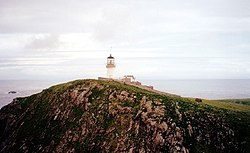 The lighthouse on Eilean Mòr. The Chapel of St Flannan can be seen on the slope to the right of the lighthouse.