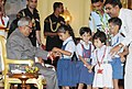 The school children tying 'Rakhi' to the President, Shri Pranab Mukherjee, on the occasion of 'Raksha Bandhan', in New Delhi on August 02, 2012 (1).jpg