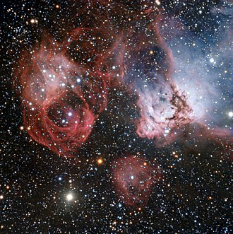 NGC 2035 - NGC 2035, just right of centre, with NGC 2032 on the right and NGC 2040 on the left (ESO)
