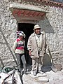 Tibet - 6020 - Happy Owner and Daughter at their barley grinding mill powered by water for grinding Tibetan native barley into tsampa.jpg