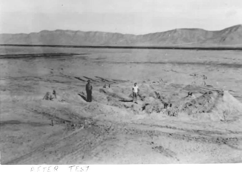 Trinity-ground-zero-men-in-crater