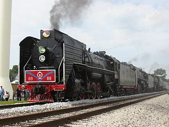 Excursion train - Preserved China Railways QJ class locomotives 6988 and 7081 operating a triple-headed excursion train with Milwaukee Road 261 on the Iowa Interstate Railroad in 2006.
