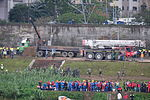 Truck Unloading Iron Plates on Park Ground 20150204.jpg