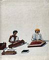 Two Indian bookbinders; one trimming page edges in a press, Wellcome V0023793.jpg