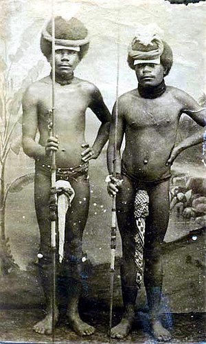Two Kanak (Canaque) warriors posing with penis gourds and spears, New Caledonia