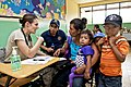 U.S. Air Force Capt. Dana Blyth, left, discusses health care with a family in Cerro Plata, Panama, on April 15, 2013 130415-A-CL600-020.jpg