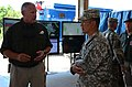 U.S. Army Brig. Gen. Clarence K. K. Chinn, right, the commanding general of the Joint Readiness Training Center and Fort Polk, La., meets with Tom Phillips, the incident commander at the Muscatatuck Urban 120801-A-IA524-863.jpg