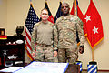 U.S. Army Maj. Gen. Robert Abrams, left, the commanding general of the 3rd Infantry Division, and Command Sgt. Maj. Edd Watson, the senior enlisted adviser with the division, stand for a photo after signing 130403-A-VM825-010.jpg