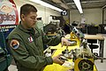 U.S. Coast Guard Aviation Maintenance Technician 2nd Class Miguel Arrellano explains an MH-65C Dolphin helicopter tail rotor assembly in the maintenance shop Coast Guard Air Station Los Angeles Jan 120113-G-MR731-070.jpg