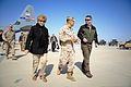 U.S. Marine Corps Brig. Gen. Daniel D. Yoo, center, the commander of Regional Command Southwest, walks with U.S. Rep. Rob Wittman, right, and Guam Del 140318-M-MF313-017.jpg