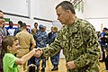 U.S. Navy Adm. James A. Winnefeld Jr., vice chairman of the Joint Chiefs of Staff, shakes hands with a boy after a USO concert in Naples, Italy, March 3, 2015 150303-D-KC128-885c.jpg