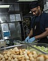 U.S. Navy Culinary Specialist 3rd Class Ontario Williams prepares salad aboard the guided missile cruiser USS Philippine Sea (CG 58) June 30, 2014, in the Persian Gulf 140630-N-PJ969-014.jpg