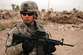 US Army 51058 BAGHDAD - Sgt. Heriberto Fuentes, of Bradenton, Fla., keeps a close watch on his surroundings while on patrol in Sadr City, here, Sept. 16. Fuentes is an infantryman assigned to the Company A, 2nd Bat.jpg