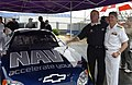 US Navy 030522-N-5862D-154 Terry Bradshaw, well-known television sportscaster and professional football legend debuts the U.S. Navy-sponsored Busch Series race car with Rear Adm. David Crocker, Commander, Operational Test and E.jpg