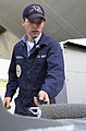 US Navy 040320-N-9319H-001 Aviation Boatswain's Mate Airman Vlad Sukliakev, of Denver, Colo., paints a watertight door.jpg