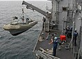 US Navy 040420-N-6433N-082 Crewmembers assigned to the Deck Department lower a Rigid Hull Inflatable Boat (RHIB) during a man overboard drill.jpg