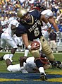 US Navy 040911-N-9693M-013 U.S. Naval Academy Midshipman 1st Class Aaron Polanco runs for a touchdown against the Northeastern Huskies.jpg