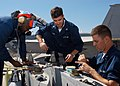 US Navy 040922-N-6060O-091 Aviation Ordnancemen work on an a weapons pylon prior to installation on an F-A-18F Super Hornet.jpg