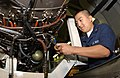 US Navy 041111-N-2143T-013 Aviation Structural Mechanic 2nd Class Chou Yang of Braselton, Ga., installs drain lines on the afterburner of an F-414 aircraft engine aboard USS Nimitz (CVN 68).jpg
