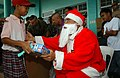 US Navy 041216-M-1188A-003 A young boy smiles as he receives a gift from Santa Claus during the last day of operations for Joint Task Force Five Three Five (JTF-535) in the Philippines.jpg