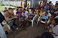 US Navy 050328-N-8629M-125 Master-at-Arms 2nd Class Mike Moore, assigned to the Military Sealift Command (MSC) hospital ship USNS Mercy (T-AH 19), teaches Indonesian children to count in English.jpg
