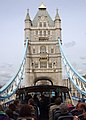 US Navy 050405-N-5345W-061 Sailors and tourists sightsee in a topless double-decker bus as they cross London, England's landmark Tower Bridge while visiting England's capital.jpg