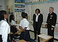 US Navy 050425-N-7975R-005 Commander, Navy Recruiting Command, Rear Adm. Jeffrey Fowler visits students at the Mathematics, Civics and Sciences Charter School of Philadelphia Inc., (MCSCS) during Philadelphia's Navy Week.jpg