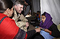 US Navy 060105-F-2729L-006 U.S. Navy Kenneth Braithwaite, assigned to the Disaster Assistance Center Pakistan, visits children at Narul Girls High School in Muzaffarabad, Pakistan.jpg
