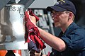 US Navy 060425-N-7987M-039 Seaman Jonathan Ringly shines the bell on the guided-missile destroyer USS James E. Williams (DDG 95).jpg