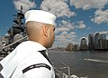 US Navy 060524-N-2555T-088 Ship's Serviceman William Rodriguez mans the rail as the ship enters New York Harbor during the parade of ships for Fleet Week 2006.jpg