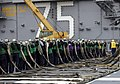 US Navy 061121-N-5283L-134 Sailors assigned to Air Department aboard USS Harry S. Truman (CVN 75) prepare to stow the aircraft barricade after flight deck drills held during a planned Fast Cruise in preparation for upcoming sea.jpg