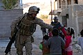 US Navy 061219-M-9019H-040 Marines assigned to 2nd Battalion, 3rd Marines (2-3) amuse Iraqi children while on patrol through the city of Haqlaniyah, during Maritime Security Operations (MSO) to develop the Iraqi Security Forces.jpg